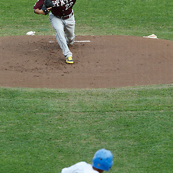 Jun 25, 2013; Omaha, NE, USA; Mississippi State Bulldogs starting pitcher Luis Pollorena (22) delivers a pitch to UCLA Bruins center fielder Brian Carroll (24) during the first inning in game 2 of the College World Series finals at TD Ameritrade Park. Mandatory Credit: Derick E. Hingle-USA TODAY Sports