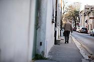 An elderly man walks down the street in St Remy de Provence, France. © Brett Wilhelm
