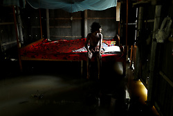 August 15, 2017 - Dhaka, Bangladesh - A child sits on a bed in a flooded home. Flood-related incidents raised the death toll to 30 people in the last three days across the country. (Credit Image: © K M Asad via ZUMA Wire)
