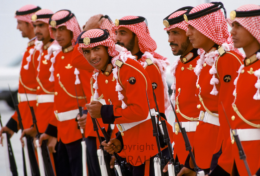 Armed soldiers parade in ceremonial uniform in Abu Dhabi