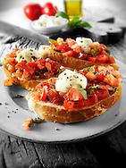 Fresh chopped beefsteak tomato with mini mozerellas bruschettas