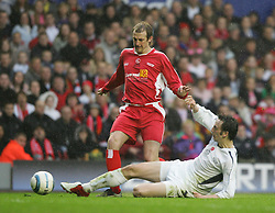 LIVERPOOL, ENGLAND - SUNDAY MARCH 27th 2005: Celebrity XI's Ralf Little tackles Liverpool Legends' Paul Dalglish during the Tsunami Soccer Aid match at Anfield. (Pic by David Rawcliffe/Propaganda)