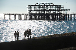© London News Pictures. 23/09/2013 . Brighton, UK.  A group of women enjoy the sunshine in front of the old Brighton Pier on Brighton beach while taking a break from the 2013 Labour Party Annual Conference which is being held at The Brighton Centre. Photo credit : Ben Cawthra/LNP
