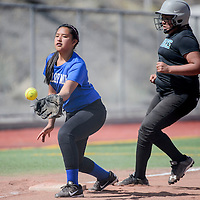 Gallup Mid School Mustang Gabby Ashley (20) makes the catch to stop Chief Manuelito Maverick Katelyn Pablo (21) at third Wednesday at Ford Canyon Park.