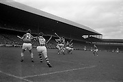 06/09/1964<br /> 09/06/1964<br /> 6 September 1964<br /> All-Ireland Senior Final: Tipperary v Kilkenny at Croke Park, Dublin.<br /> Tipperary backs clearing during the early stages of the game. Tipperary right full back, J. Doyle (2) and Kilkenny left full forward, T. Murphy, await the outcome of the midfield tussel.