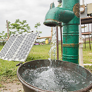 CAPTION: DESI Power's solar-powered pump enables users to draw water without having to manually pump the handle. LOCATION: Gayari, Araria District, Bihar, India. INDIVIDUAL(S) PHOTOGRAPHED: N/A.