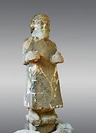 Pictures & images of the South Gate Hittite sculpture statue of Hittite Storm God Tarhunzas ( Tarḫunz Tarḫunna or in Hurrian Teshub or in Phoenician Baal Krntrys ). 8th century BC. Karatepe Aslantas Open-Air Museum (Karatepe-Aslantaş Açık Hava Müzesi), Osmaniye Province, Turkey.  Against grey background