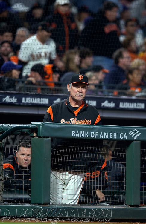 Sep 27, 2019; San Francisco, CA, USA; San Francisco Giants manager Bruce Bochy (15) watches his team take on the Los Angeles Dodgers during the second inning of a baseball game at Oracle Park. Mandatory Credit: D. Ross Cameron-USA TODAY Sports