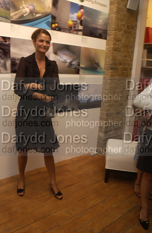 Helena Christensen. Helena Christensen: An Eye For Beauty - private view. Sony Ericsson Proud Camden, Stables Market, The Gin House, London, NW1. 1 September 2005. ONE TIME USE ONLY - DO NOT ARCHIVE  © Copyright Photograph by Dafydd Jones 66 Stockwell Park Rd. London SW9 0DA Tel 020 7733 0108 www.dafjones.com