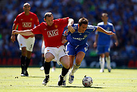 Photo: Richard Lane/Sportsbeat Images.<br />Manchester United v Chelsea. FA Community Shield. 05/08/2007. <br />United's Wayne Rooney and Chelsea's Frank Lampard challenge for the ball.