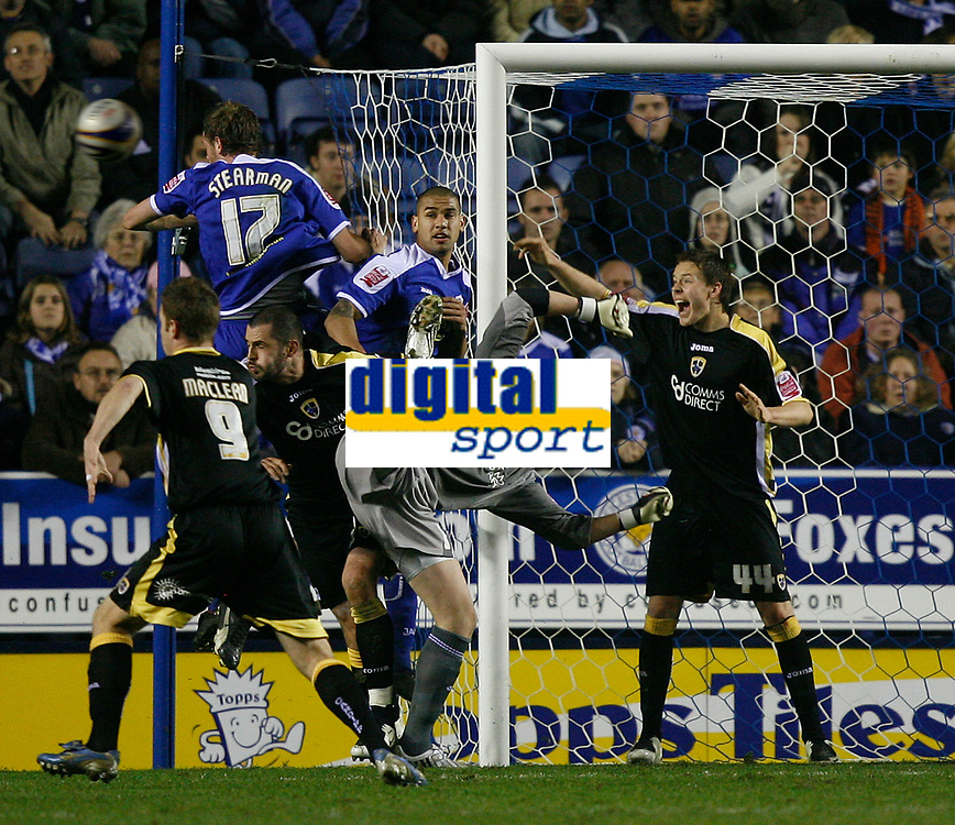 Photo: Steve Bond.<br />Leicester City v Cardiff City. Coca Cola Championship. 26/11/2007. Keeper Kasper Schmeichel under pressure from Richard Stearman (top left) as Cardiff defend desparately. Chris Gunter guards the near post