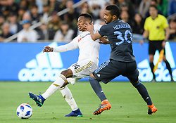 May 13, 2018 - Los Angeles, CA, U.S. - LOS ANGELES, CA - MAY 13: New York City midfielder Yangel Herrera (30) gets a hand to the face of Los Angeles FC midfielder Mark-Anthony Kaye (14) during the game between New York City FC and the Los Angeles FC on May 13, 2018, at Banc of California Stadium in Los Angeles, CA. (Photo by David Dennis/Icon Sportswire) (Credit Image: © David Dennis/Icon SMI via ZUMA Press)