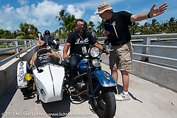 Jake and Ginger Martin riding their 1941 Harley-Davidson FL Knucklehead with a sidecar as they pull into the staging area before the finish of the Cross Country Chase motorcycle endurance run from Sault Sainte Marie, MI to Key West, FL. (for vintage bikes from 1930-1948). The staging area on a Key West pier just before the finish and near the end of the 110 mile Stage-10 ride from Miami to Key West, FL USA. Sunday, September 15, 2019. Photography ©2019 Michael Lichter.