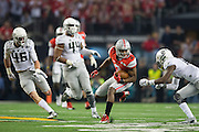 Michael Thomas #3 of the Ohio State Buckeyes breaks free after a catch against the Oregon Ducks during the College Football Playoff National Championship Game at AT&T Stadium on January 12, 2015 in Arlington, Texas.  (Cooper Neill for The New York Times)