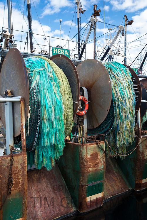 Bright colour plastic rope nets on reel mechanism of fishing boats fleet in Massachusetts, USA