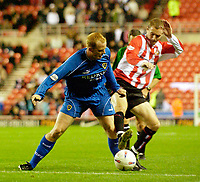 Photo. Jed Wee.<br /> Sunderland v Cardiff City, Nationwide League Division One, Stadium of Light, Sunderland. 14/10/03.<br /> Sunderland's Colin Healy (R) tries to dispossess Cardiff's Andy Campbell.
