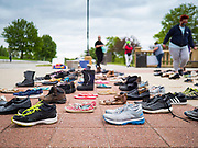 18 MAY 2020 - DES MOINES, IOWA: A memorial consisting of empty shoes in front of the Iowa state capitol in Des Moines. Each Pair Iowa put together a memorial of empty shoes to represent Iowans killed by the COVID-19 pandemic. The memorial is traveling around the state. As of May 18, 355 people in Iowa have died from COVID-19, the disease caused by the Coronavirus (SARS-CoV-2), and 14,955 have tested positive for the Coronavirus.       PHOTO BY JACK KURTZ