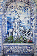 Old azulejos, the iconic blue-glazed ceramic tile work from the area, in the beautiful gardens of the Palacio de Fronteira, in Lisbon, Portugal
