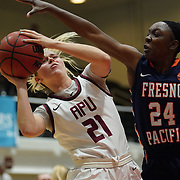Azusa Pacific guard Daylee Hanson (21) tries to get a shot off past the defense of Fresno Pacific guard Ashley Cross (24) during the first quarter of the PacWest basketball championships semi-finals in the Felix Event Center at Azusa Pacific University Friday, Mar. 6, 202, in Azusa. (Mandatory Credit: Christina Leung-Sports Shooter Academy)