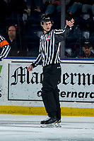 KELOWNA, BC - FEBRUARY 28: Linesman Dave McMahon calls for the puck for the face-off between Kelowna Rockets and Everett Silvertips at Prospera Place on February 28, 2020 in Kelowna, Canada. (Photo by Marissa Baecker/Shoot the Breeze)