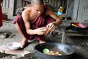 A monk makes breakfast at Shwe Pan Myaing Monastery in Mandalay on 25th May 2016 in Myanmar