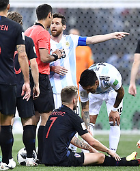 NIZHNY NOVGOROD, June 21, 2018  Lionel Messi (C) of Argentina talks with the referee during the 2018 FIFA World Cup Group D match between Argentina and Croatia in Nizhny Novgorod, Russia, June 21, 2018. (Credit Image: © Chen Yichen/Xinhua via ZUMA Wire)