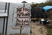 France. Refugees. Calais. The much visited so-called Jungle camp . Sign on a shelter saying 'No photo no tourist'.