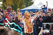 """SHOT 10/22/17 9:38:25 AM - The ketchup and mustard shower while tailgating at the Hammer's Lot at the Pinto Ron tailgate party before the Buffalo Bills faced the Tampa Bay Buccaneers in Orchard Park, N.Y. Ken Johnson, better known as """"Pinto Ron"""", (born 1958) is a Buffalo Bills fan known for attending every single Bills home and away game and hosting a tailgate party since 1994. He is known for his red Ford Pinto and antics cooking food on his car hood in a variety of objects such as a shovel and army helmet; furthermore, he holds a tradition of being doused in ketchup and mustard. Most notably he served shots out of a bowling ball until he was forced to shut down by the National Football League (NFL) Johnson moved his tailgate party to private property next to the stadium where the NFL has no jurisdiction and was able to resume serving bowling ball shots. He has been featured in multiple NFL Films, as well as the made-for-TV movie Second String. (Photo by Marc Piscotty / © 2017)"""