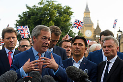 © Licensed to London News Pictures. 24/06/2016. London, UK. UKIP leader NIGEL FARAGE delivers a victory speech in front of parliament on the day that the UK voted to leave the EU in a referendum. Photo credit: Ben Cawthra/LNP