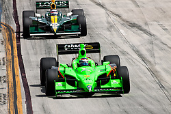 LONG BEACH, CA - APR 17: IndyCar Series driver Danica Patrick drives car #7 of Andretti Autosport leading other drivers during a yellow flag warning. Photo by Eduardo E. Silva