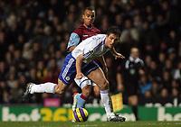 Photo: Paul Thomas.<br /> Aston Villa v Chelsea. The Barclays Premiership. 02/01/2007.<br /> <br /> Frank Lampard (White) of Chelsea gets past Gabriel Agbonlahor.