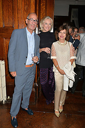 Left to right, DIDIER KRZENTOWSKI Director of Galerie Kreo, SOPHIE FRYDMAN and PILAR BOXFORD at a party to celebrate opening of Galerie Kreo in London held at Il Bottaccio, Grosvenor Place, London on 17th September 2014.
