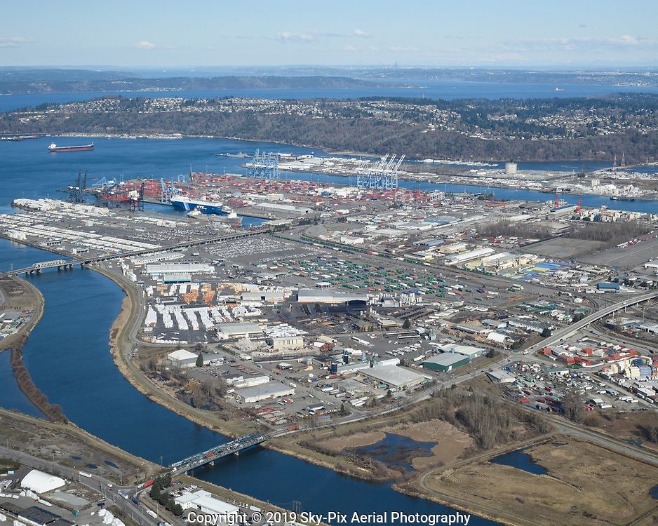 The Port Of Tacoma at Lincoln Avenue and the Puyallup River with Seattle in the distant background.