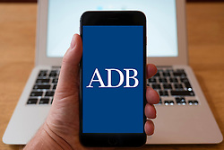 Using iPhone smart phone to display website logo of the Asian Development Bank