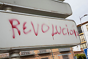 Revolution graffiti in the struggling town of Loja, Granada Province, Andalucia, Spain. The economic downturn in Europe has his towns like this hard. Recession means that a once bsutling town is now boarded up and quiet.