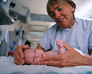 Dr. Tiffany Field of the Touch Research Institute who through many studies has determined that stimulating Preterm Neonates increased the rate they grrew and were released from the hospital on average 10 earlier than a control group.  The healthcare saving of 470,000 premature births would be a saving she said of some 4.7 billion dollars a year.