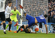 Chelsea striker Diego Costa tries everything he can to get past Everton defender Leighton Baines but ends up conceding a foul during the Barclays Premier League match between Chelsea and Everton at Stamford Bridge, London, England on 16 January 2016. Photo by Andy Walter.