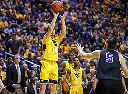 Mar 20, 2019; Morgantown, WV, USA; West Virginia Mountaineers guard Chase Harler (14) shoots a three pointer during the second half against the Grand Canyon Antelopes at WVU Coliseum. Mandatory Credit: Ben Queen