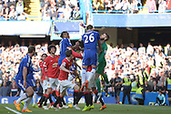 David De Gea of Manchester United punches the ball clear over John Terry, the Chelsea captain. Barclays Premier league match, Chelsea v Manchester Utd at Stamford Bridge Stadium in London on Saturday 18th April 2015.<br /> pic by John Patrick Fletcher, Andrew Orchard sports photography.