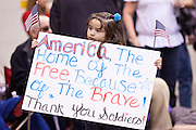 """15 JANUARY 2012 - PHOENIX, AZ:   A girl carries a sign while waiting for soldiers to come home at the The 161st Air Refueling Wing of the Arizona Air National Guard in Phoenix. About 100 soldiers of A (Alpha) Company of the 422nd Expeditionary Signal Battalion (referred to as """"Alpha 4-2-2"""") of the Arizona Army National Guard returned to Arizona on Sunday, Jan. 15, following a nearly year-long deployment to Afghanistan. More than 10,000 Arizona Army and Air National Guard Soldiers and Airmen have been ordered to federal active duty in support of Operations Noble Eagle, Enduring Freedom, Iraqi Freedom, and New Dawn since September 2001. Approximately 200 Arizona National Guard Soldiers and Airmen are still serving on federal active duty overseas. PHOTO BY JACK KURTZ"""