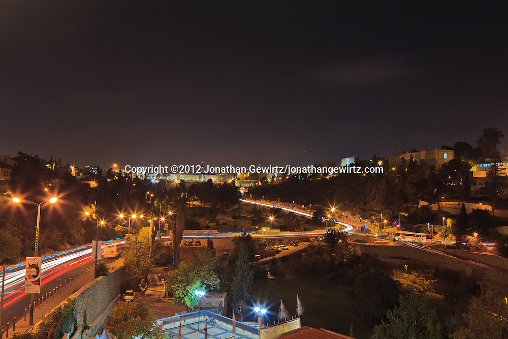 Night traffic along Derech Hevron and Hativat Yerushalayim heading towards the Jaffa Gate in Jerusalem's Old City. WATERMARKS WILL NOT APPEAR ON PRINTS OR LICENSED IMAGES.