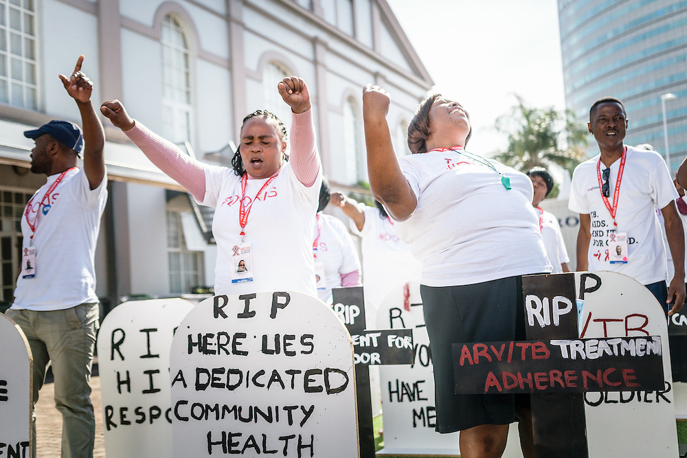 """Protestors demand better treatment for caregivers and health workers at the 2016 International AIDS Conference in Durban, South Africa, saying """"When health workers suffer, society suffers""""."""