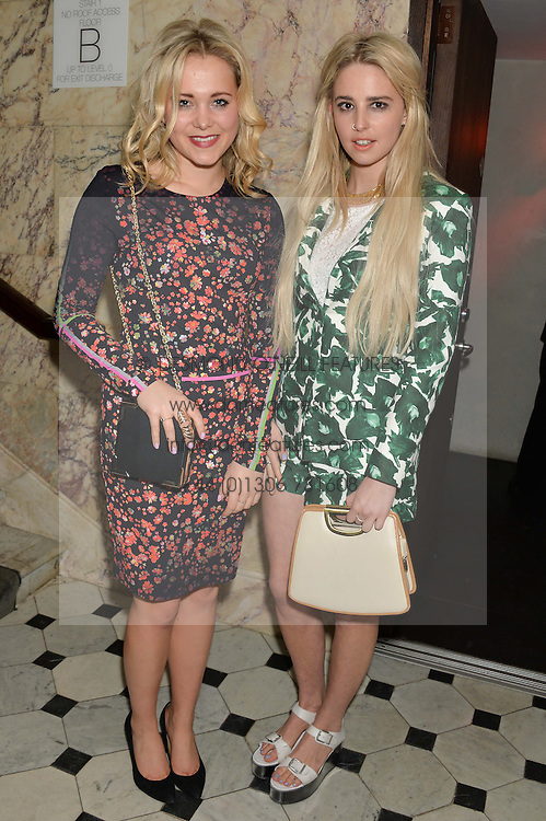 Left to right, POPPY JAMIE and singer LAUREL (Laurel Arnell-Cullen) at the Lancôme pre BAFTA party held at The London Edition, 10 Berners Street, London on 14th February 2014.