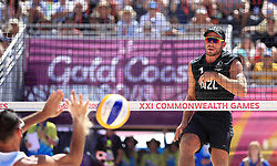 New Zealand's Ben O'Dea scores the winning point during the Men Preliminary - Pool C Beach Volleyball match against Cyprus at Coolangatta Beachfront during day two of the 2018 Commonwealth Games in the Gold Coast, Australia.