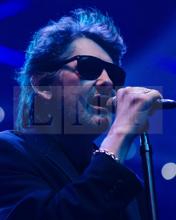 © Licensed to London News Pictures. 20/12/2012. London, UK.   Shane MacGowan of The Pogues performing live at The O2 Arena for their only UK live date of 2012 as part of their 30th Anniversary Tour.  The Pogues are a Celtic punk band from London, formed in 1982 and fronted by Shane MacGowan.  Members include Shane MacGowan (vocals, guitar, banjo, bodhrán),.Spider Stacy (vocals, tin whistle), Jem Finer (banjo, mandola, saxophone, hurdy-gurdy, guitar, vocals), Andrew Ranken (drums, percussion, harmonica, vocals), .James Fearnley (accordion, mandolin, piano, guitar), .Philip Chevron (guitar, vocals),  Darryl Hunt (bass guitar),.Terry Woods (mandolin, cittern, concertina, guitar, vocals).     Photo credit : Richard Isaac/LNP