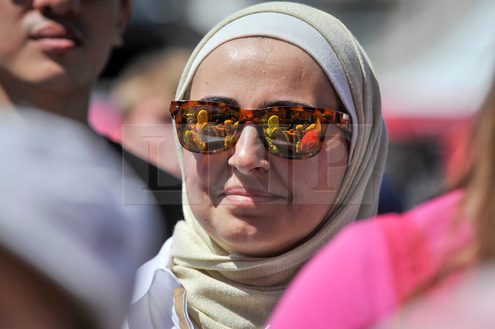 © Licensed to London News Pictures. 02/07/2017. London, UK. A woman watches a stage performance.  People celebrate the EID Festival in Trafalgar Square, an event hosted by The Mayor of London.  The Mayor's festival takes place in the square one week after the end of Ramadan and includes a variety of stage performances and cultural activities. Photo credit : Stephen Chung/LNP