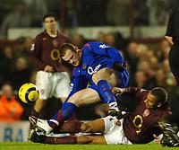Photo: Daniel Hambury.<br />Arsenal v Manchester United. The Barclays Premiership.<br />03/01/2006.<br />Arsenal's Gilberto tackles United's Wayne Rooney with both feet.