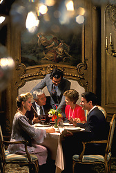 Stock photo of two couples dining together in an upscale restaurant