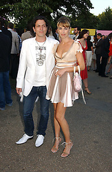 STEPHEN & ASSIA WEBSTER, he is the jeweller at the Serpentine Gallery Summer party sponsored by Yves Saint Laurent held at the Serpentine Gallery, Kensington Gardens, London W2 on 11th July 2006.<br /><br />NON EXCLUSIVE - WORLD RIGHTS