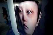 "Seoul/South Korea, Republic Korea, KOR, 02.12.2009: Seoul International Photography Festival 2009 - Reflections in the photograph ""Duzas tears"" by Photographer Oleg Dou."